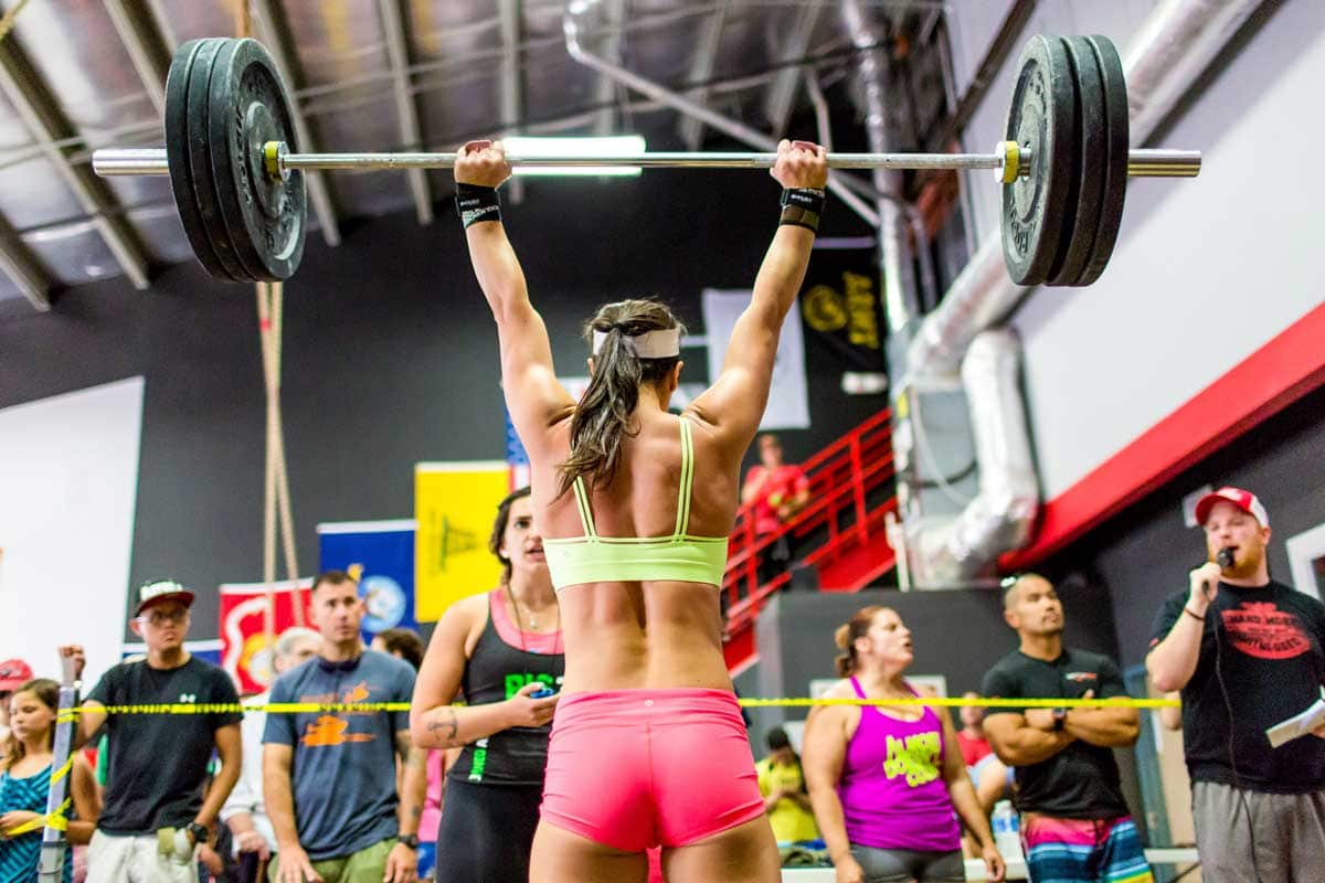 crossfit athlete performing-overhead barbell movement