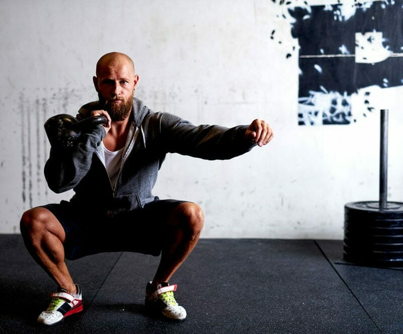 CrossFit training techniques squat with kettlebell