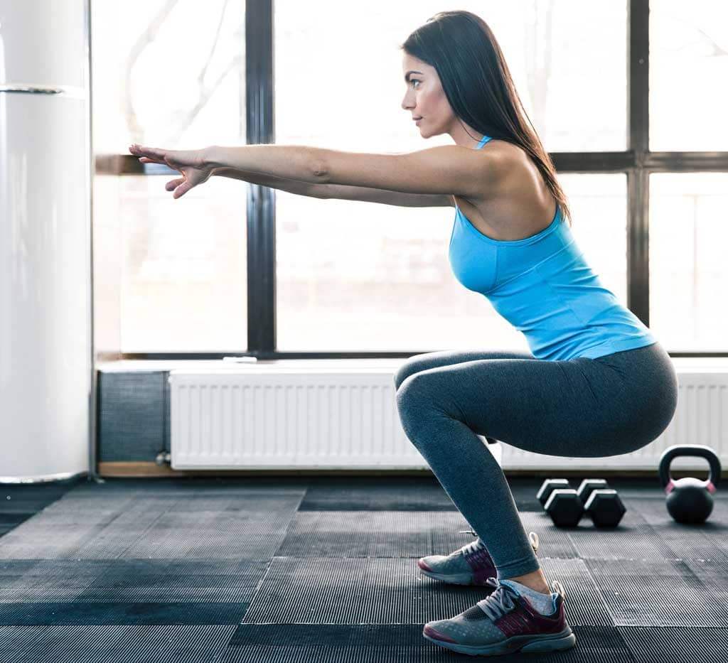 woman squatting correctly