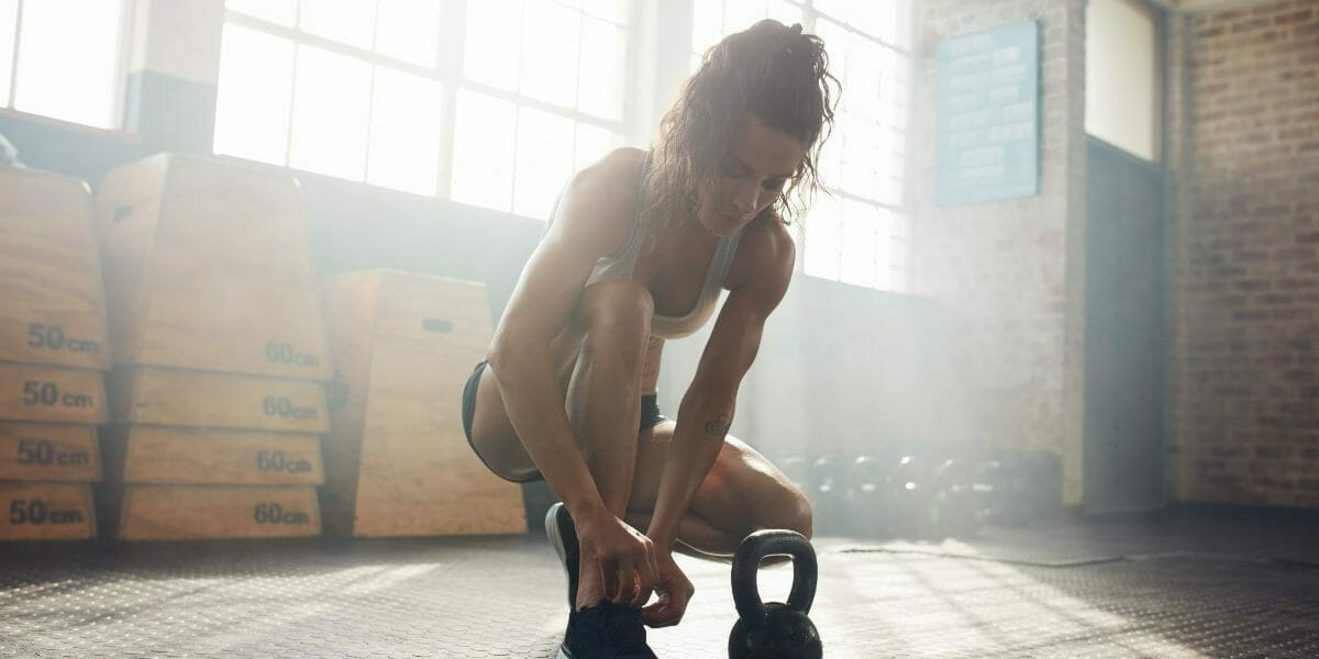 Woman getting ready to workout at the CrossFit gym