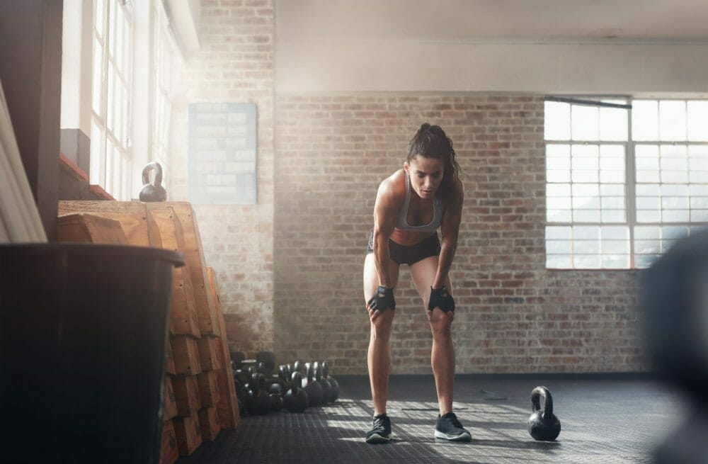 Fitness woman with gloves after intense workout