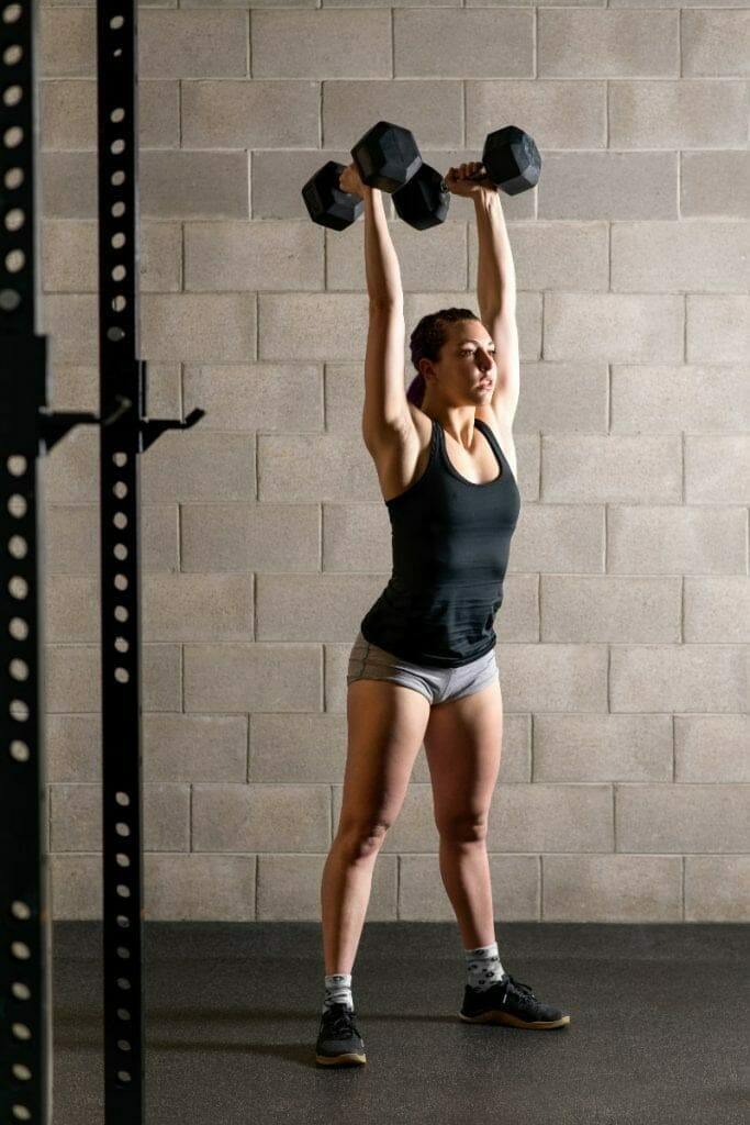 CrossFit athlete performing dumbbell snatch