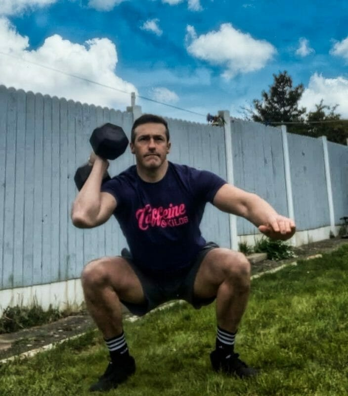 Bottom Of The Single Arm Squat Clean And Press