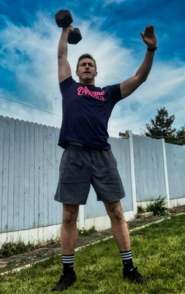 Standing Position Overhead Dumbbell