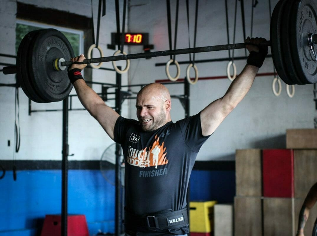 Crossfit Athlete Performing Snatch With Wrist Supports