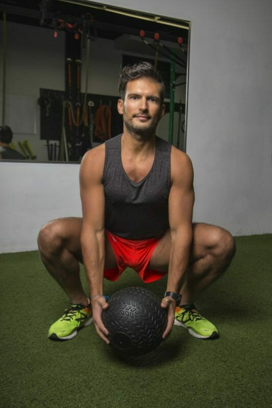 Squatting With Weighted Ball