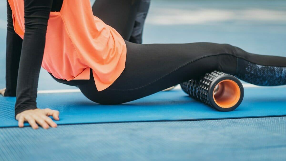 Female CrossFit athlete massage hamstrings